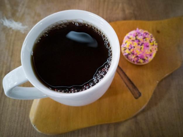 White coffee mug and cake