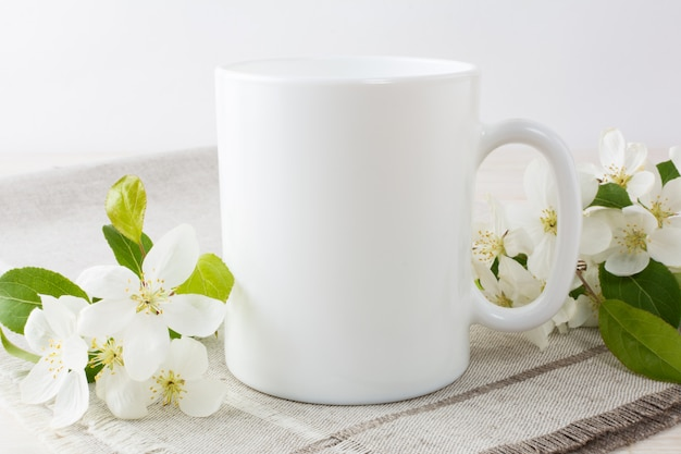 White coffee mug mockup with apple blossom