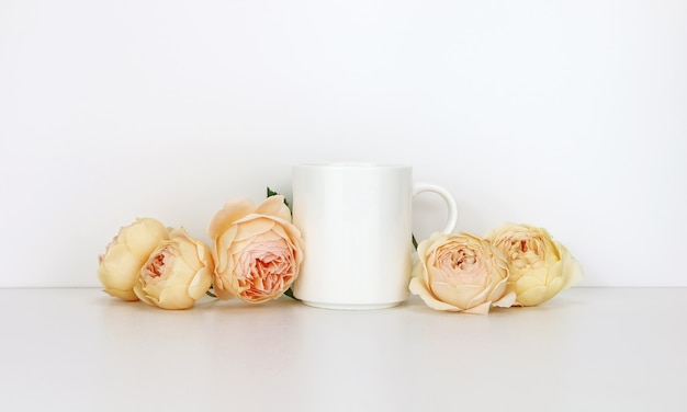 White coffee mug  with roses. blank mug mock up for design promotion.