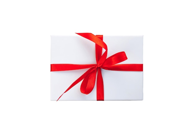 White color gift box with red ribbon and bow isolated on white  top view close up. selective soft focus. text copy space. holiday present concept
