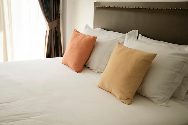 White and color pillow in bedroom