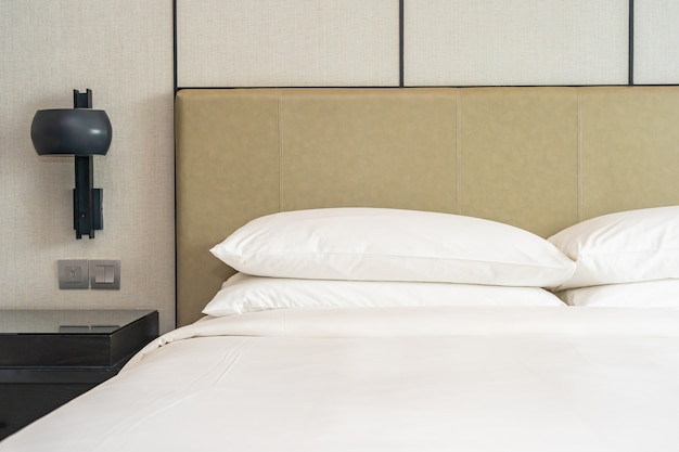 White comfortable pillow decoration interior of bedroom