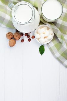 White composition of milk with wooden background