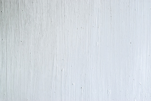 White concrete wall with paint brush strokes