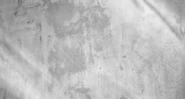White concrete wall with shadows from the window. abstract background