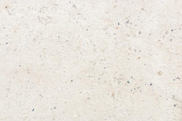 그것에 작은 돌으로 흰 콘크리트 벽입니다. 차가운 미니멀리즘 배경 디자인