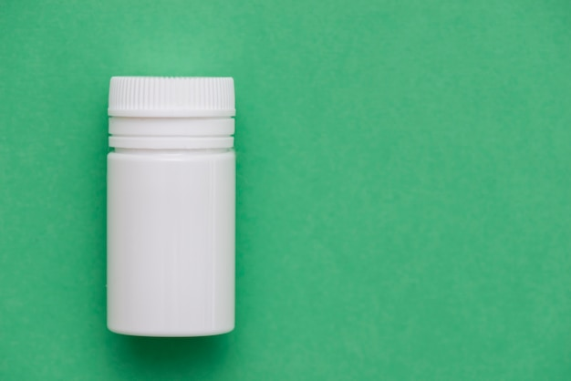 White container on green background