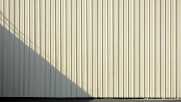 White corrugated metal wall with shadow