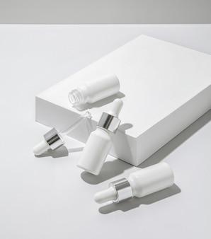 White cosmetic bottles on white