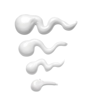 White cosmetic cream strokes isolated on white