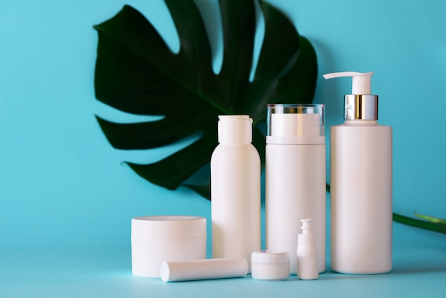 White cosmetic tubes on blue background