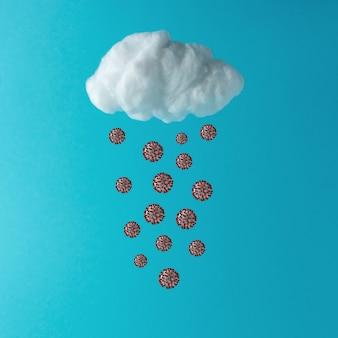 青い背景にコロナウイルスと白い綿の雲
