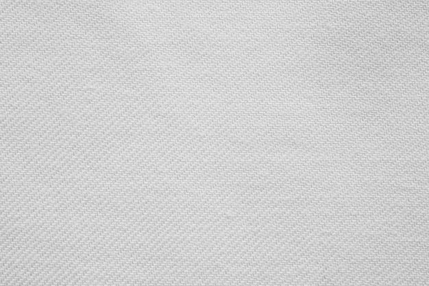 白い綿生地の布のテクスチャパターンの背景