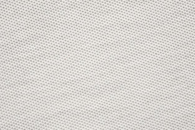 白い綿生地の布のテクスチャパターン