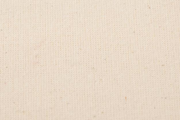 背景として白い綿生地の質感