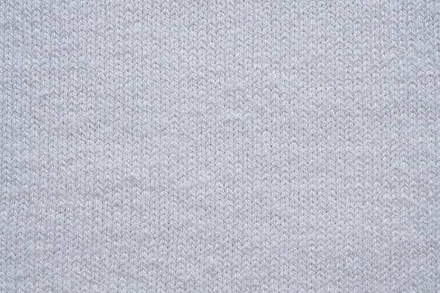 白い綿生地のテクスチャのクローズアップの背景
