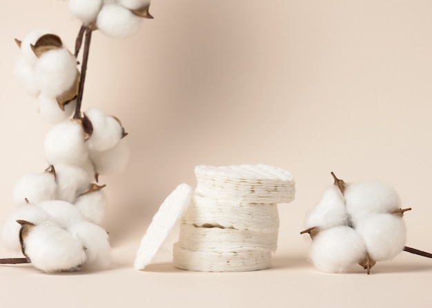 White cotton sponges on beige background. design for the beauty, medicine and cosmetics industry