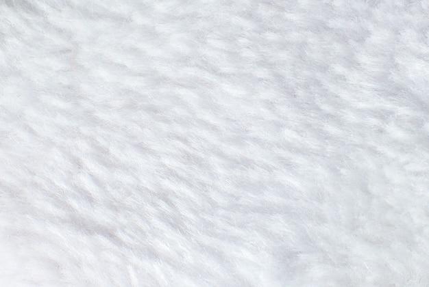 Белое хлопковое полотенце или ковер пушистая текстура фон. фото крупным планом.