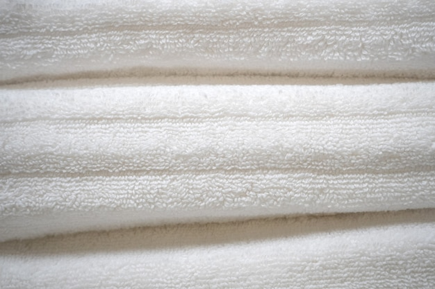 White cotton towels stacked on top of each other close up