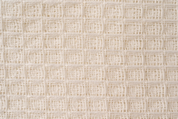 White cotton waffle fabric texture as background or design element. cotton fabric white color