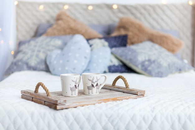 White cozy bed and christmas lights