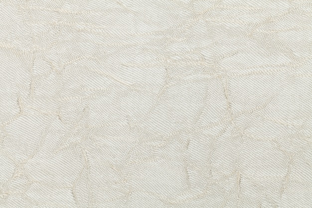 White cream background from textile material