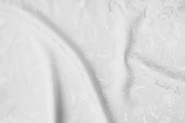 White creased fabric texture background.