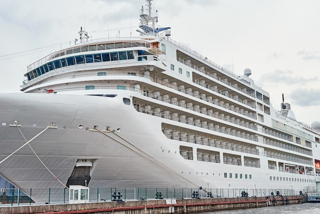 White cruis ship liner docked in the port