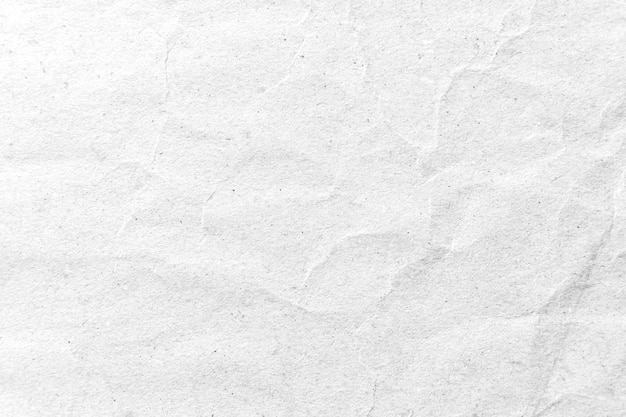White crumpled paper background.