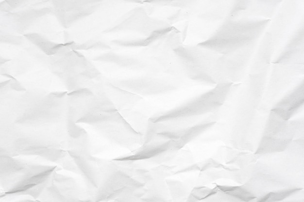 9838543b0355 White crumpled paper texture background.