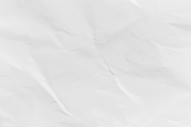 デザインのための白いしわくちゃの再生紙のテクスチャ背景。