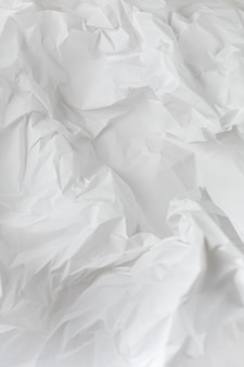 White crumpled wrapping paper background with texture and place for text