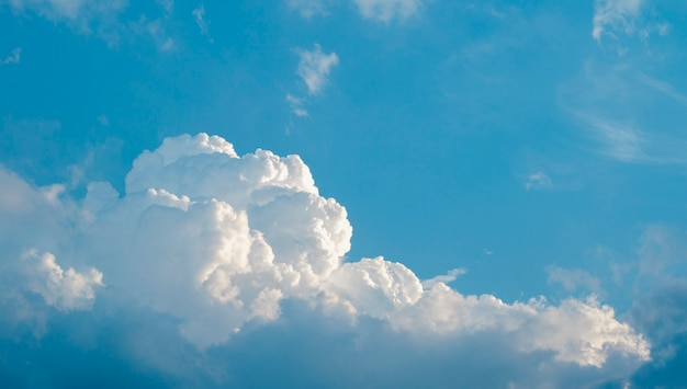 White cumulus clouds in the blue sky background