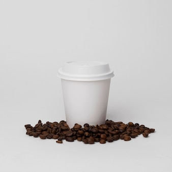 White cup on coffee beans arrangement