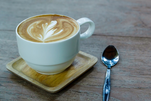 White cup of coffee latte on desk wooden, time already been enjoy coffee, soft focus on capuccino coffee