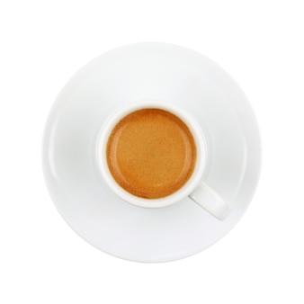 Белая чашка, полная кофе эспрессо с коричневыми сливками