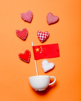 White cup and heart shapes with china flag