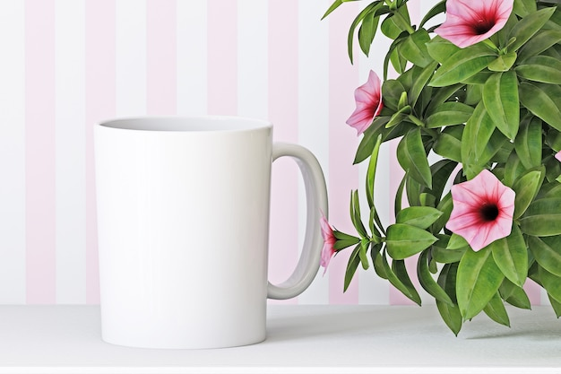 White cup mockup on flowers background