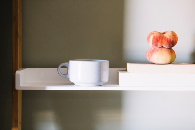 White cup and peaches