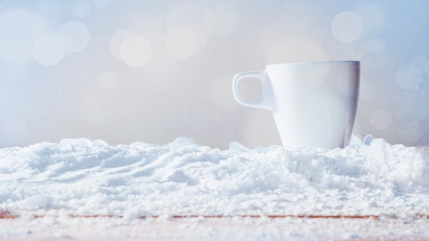 White cup placed on snow