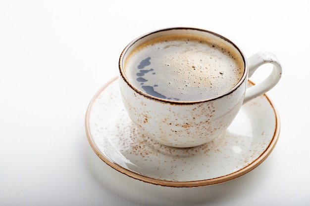 White cup with cappuccino coffee.