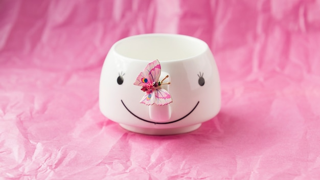 White cup with pink background