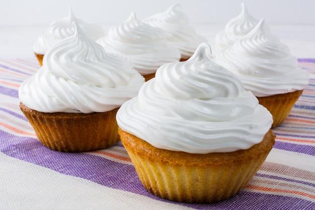 White cupcakes on the linen napkin