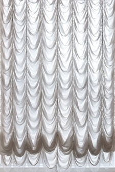 White curtains draped theater. curtains background.