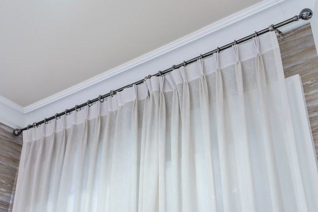 White curtains with ring-top rail, curtain interior decoration in living room