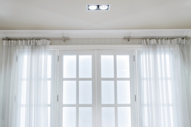 White curtains with ring-top rail