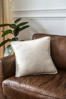 White cushion on a leather couch