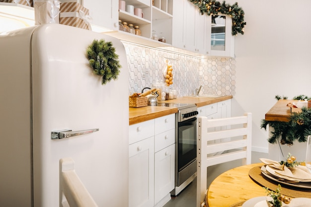 White decorated christmas kitchen with refrigerator