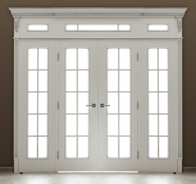 A white decorated  double door with glass