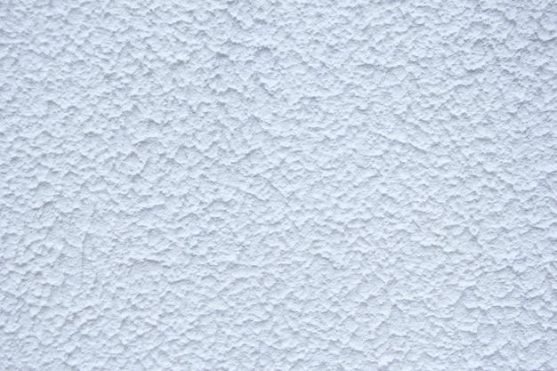白い装飾的な石膏。漆喰壁の質感。白いテクスチャの背景。